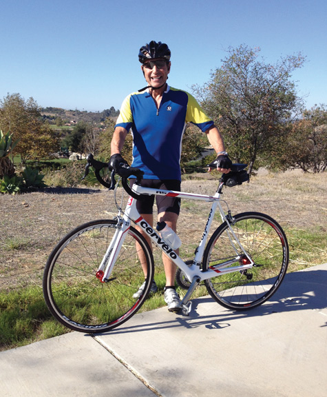 Barry H. Greenberg, MD, rests for a few moments in the midst of a training ride on his favorite local course in San Diego.
